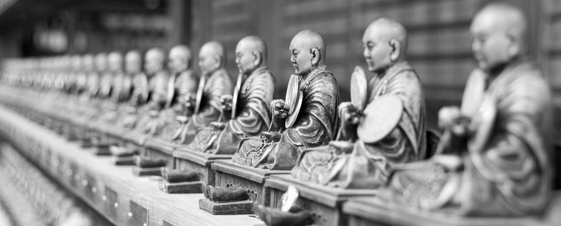 Rows of Tiny Buddhas