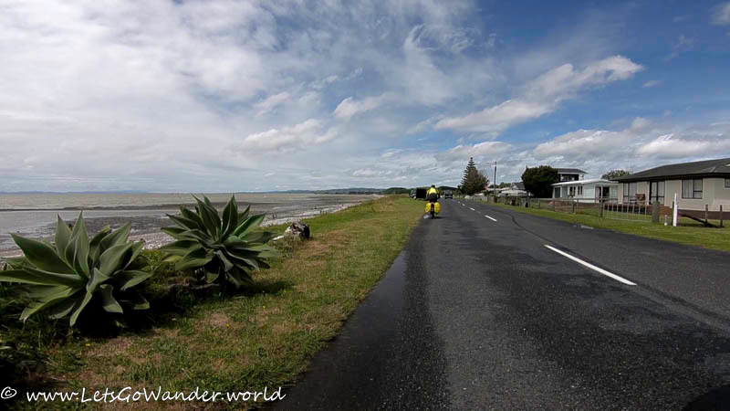 Riding between Orere Point and Thames on a windy day.